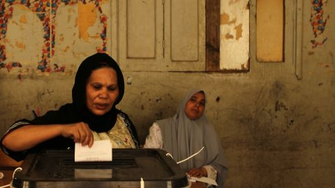 An Egyptian Coptic Christian woman casts her vote in the Cairo Coptic neighborhood of Shubra.