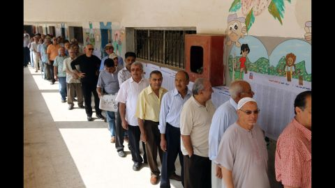 Egyptians queue outside a polling station in Cairo.