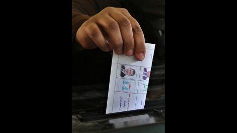 An Egyptian woman casts her ballot in Cairo.
