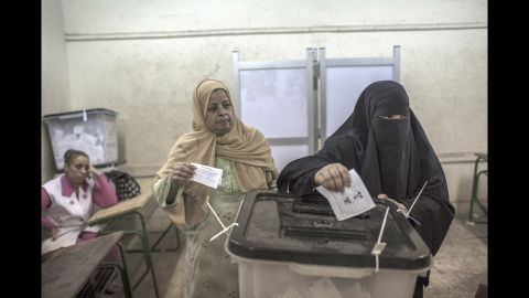 Egyptian women cast their votes at a polling station.