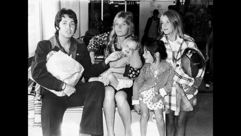 McCartney with his first wife, Linda Eastman, and their daughters Stella (from left), Mary and Heather, at Heathrow Airport in London in 1974.