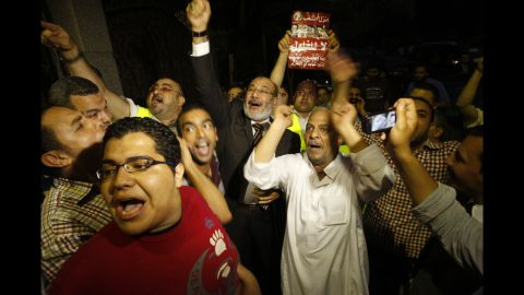 Morsi supporters celebrate Monday in Cairo. Votes in the Egyptian capital, the largest population center, continued to be tallied, but unofficial results by a state-run news website showed Morsi leading elsewhere with 11.2 million votes, compared with 10.3 million for Ahmed Shafik, the last prime minister in the waning days of Mubarak's regime.