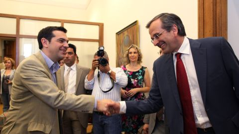 Antonis Samaras, right, meets with Greece's Syriza party leader Alexis Tsipras in an attempt to form a coalition government Monday. Tsipras immediately announced the party would go into opposition rather than support Samaras.