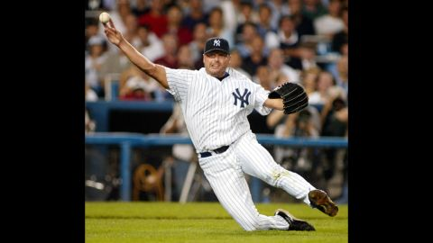 As the Yankees' starting pitcher, Clemens throws out Los Angeles Angel's Darin Erstad during the first game of the American League Division Serios in 2002.