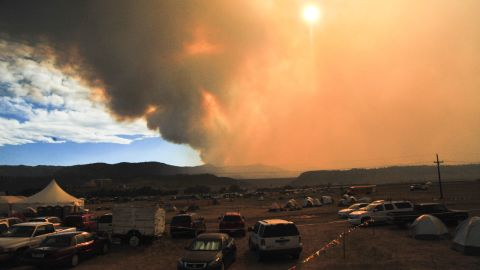 Smoke from the High Park Fire rises above the Colorado National Guard Readiness Center near Fort Collins on Sunday, June 17.