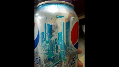 """CNN iReporter Lyndsay Brock, working at the Baghdad Diplomatic Support Center in Iraq, <a href=""""http://ireport.cnn.com/docs/DOC-719248"""">shared this photo</a> of a Diet Pepsi can that caused some controversy online in 2011. Some said the imagery resembled the Twin Towers and a plane flying overhead. Pepsi responded that any such resemblance was unintentional and that the design was inspired by the skyline in Dubai, United Arab Emirates."""