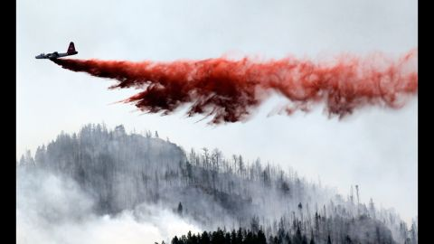 """A heavy air tanker drops fire retardant on the blaze June 19. Its growth potential was """"extreme,"""" according to authorities."""