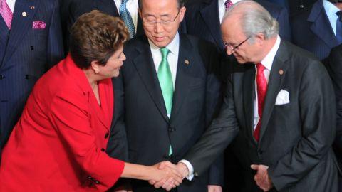 Brazil's President Dilma Rousseff, left, greets Sweden's King Carl Gustaf as U.N. Secretary-General Ban Ki-moon looks on.