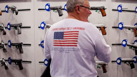 A gun enthusiast looks at a Smith & Wesson display at  NRA's annual meeting April 14 at America's Center in St. Louis.
