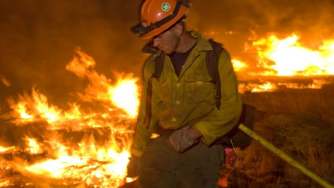 """<a href=""""http://www.kariphotos.com/"""" target=""""_blank"""" target=""""_blank"""">Photographer Kari Greer </a>has spent years documenting wildfires and firefighters in much of the United States. In this photo, a firefighter works a low-intensity burn operation June 14 at Lincoln National Forest in New Mexico."""
