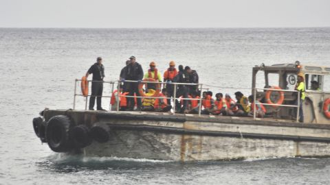 So far, rescuers have saved 110 people from the ship, authorities say. Survivors have been transfered to Christmas Island.