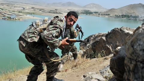 Afghan National Army soldiers stake out positions on a hill near the hotel Friday. The standoff, which lasted 11 hours, ended with the deaths of seven militants, police said.