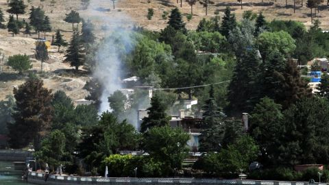 Smoke rises from the hotel where police eventually rescued 50 civilians who had been held hostage.