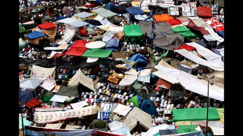 Protesters perform Friday noon prayer under tents erected in Cairo's landmark Tahrir Square.