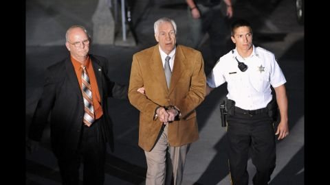A view from above as Sandusky is led fromt he courthouse in handcuffs.