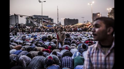 Protesters take a break from shouting slogans to pray in Tahrir Square.