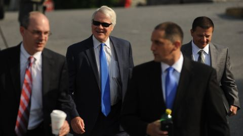 Prosecutor Joseph E. McGettigan III, second from left, and the rest of his prosecution team arrive at the courthouse Friday.