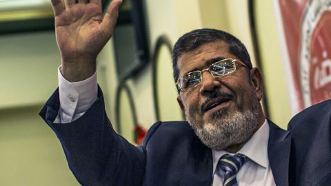 Mohamed Morsi of the Muslim Brotherhood addresses suporters at a press conference on June 13, 2012 in Cairo, Egypt.