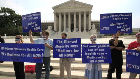 Protesters gather in front of U.S. Supreme Court Monday, June 25, 2012 as the ruling on the constitutionality of the sweeping health care law championed by President Barack Obama draws neigh.
