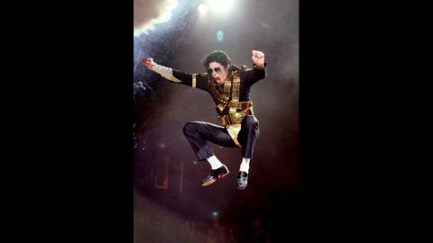 Known for his dance moves, Jackson is seen here jumping while performing during the Dangerous tour in 1992.