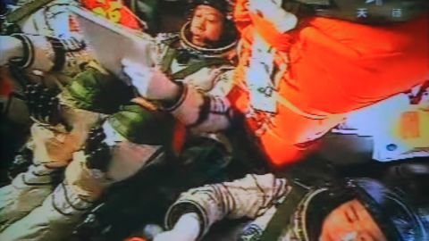 Three Chinese astronauts in the Shenzhou-9 spacecraft prepare for docking with the Tiangong-1 module on July 18, 2012.