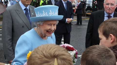 Queen Elizabeth II is in Northern Ireland for a historic meeting with Martin McGuinness, a former IRA leader.