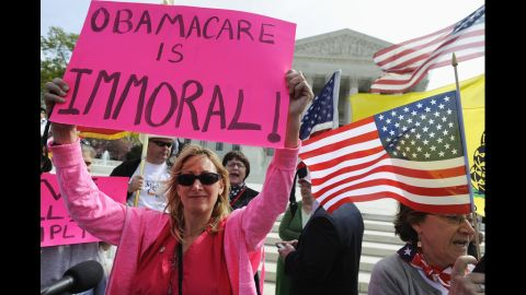 Opponents of Obama's health care legislation protest in front of the Supreme Court on March 28. Critics argued the law's requirement that most Americans have health insurance or pay a fine was an unconstitutional intrusion on individual freedom.