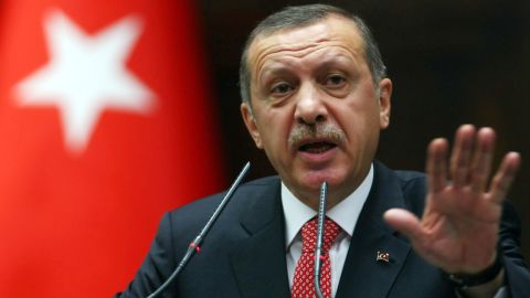 Turkish Prime Minister Recep Tayyip Erdogan addresses the lawmakers of his Justice and Development Party at the parliament in Ankara, on June 26, 2012.