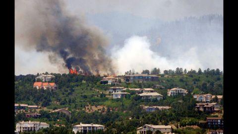 Trees burn on a ridge above Cedar Heights in Colorado Springs, Colorado, on June 24.