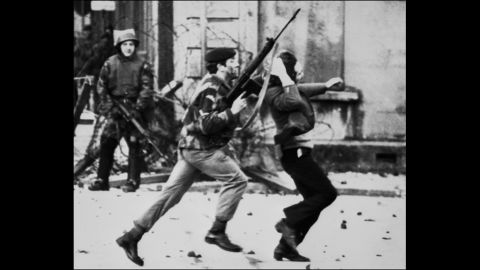 """A British soldier drags a Catholic protester on """"Bloody Sunday,"""" when British paratroopers shot and killed 13 Catholic civil rights marchers in Londonderry, Northern Ireland, on January 30, 1972. Shortly after, the Irish Republican Army declared that its immediate policy was """"to kill as many British soldiers as possible."""""""