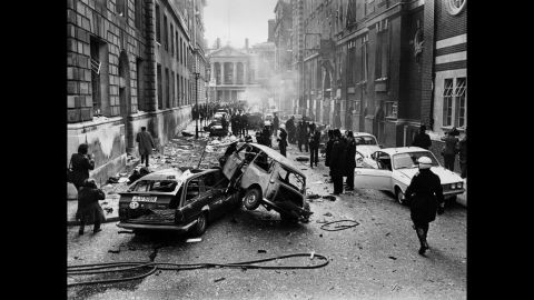 Damage caused by an IRA bombing on March 8, 1973, litters a street in London. That year, the IRA resolved to expand its attacks to create more violence in mainland Britain.