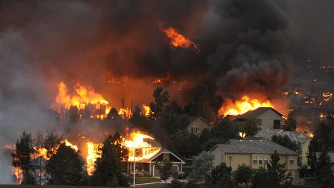 """The Waldo Canyon fire spreads through a neighborhood in the hills above Colorado Springs on June 26. See more photos at <a href=""""http://www.denverpost.com/"""" target=""""_blank"""" target=""""_blank"""">The Denver Post</a>."""