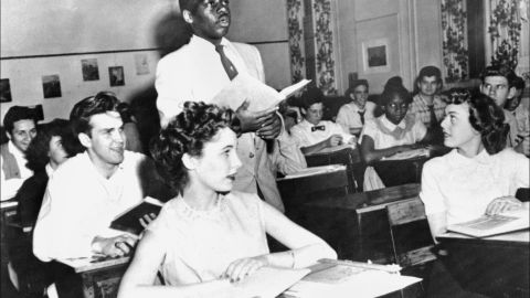 <strong>Brown v. Board of Education (1954):</strong> Nathaniel Steward recites his lesson surrounded by white classmates at the Saint-Dominique School in Washington. In Brown v. Board of Education, the Supreme Court ruled that it was unconstitutional to separate students based on race.