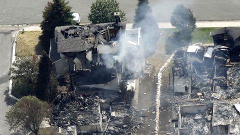 A partially burned home smolders Thursday in Colorado Springs.