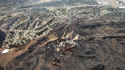 The line where the Waldo Canyon Fire stopped moving east is seen from the air in Colorado Springs. Lower temperatures and lighter winds helped firefighters on Thursday in the battle against the fire.