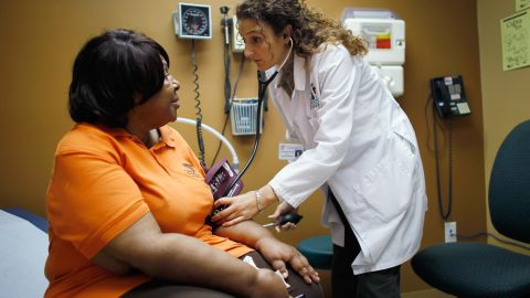 Brenda Major (L), who said she had a pre-existing condition that made it impossible to find insurance that would cover her until the Affordable Care Act, is examined by Dr. Fernanda Mercade during a routine checkup at the Jessie Trice Center for Community Health clinic on March 22, 2012 in Miami, Florida. Starting on March 26, 2012 the arguments begin on the Affordable Care Act before the U.S. Supreme Court. The Act, which was set into law by U.S. President Barack Obama, helps many in need of health care like Brenda Major who now has insurance after being denied health insurance coverage due to her pre-existing condition. (Photo by Joe Raedle/Getty Images)