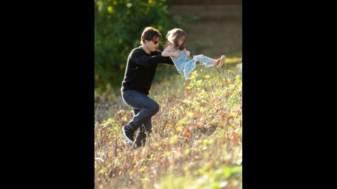 """Cruise plays with Suri in Cambridge on October 10, 2009. Cruise's lawyer said the actor """"is very sad about [the divorce] and is concentrating on the kids."""""""