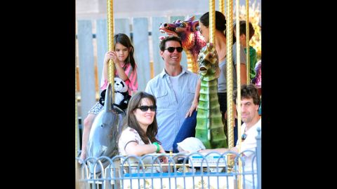 """Cruise and Holmes visit Schenley Plaza's carousel with daughter Suri in October 2011 in Pittsburgh.  Holmes' lawyer released a statement saying, """"This is a personal and private matter for Katie and her family. Katie's primary concern remains, as it always has been, her daughter's best interest."""""""