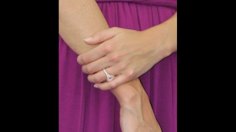 """Holmes shows off her engagement ring at a """"War of the Worlds"""" film promotion in Marseille, France, in June 2005."""