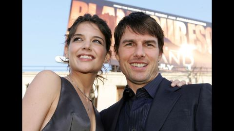 """Holmes and Cruise are all smiles at the premiere of """"Batman Begins"""" in 2005."""