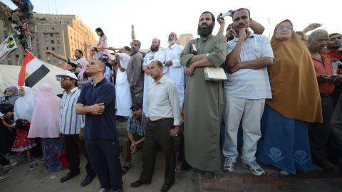 Egyptians in Cairo's Tahrir Square listen to a speech from President-elect Mohamed Morsi on Friday.