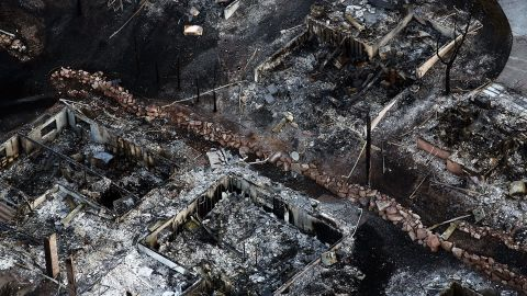 Homes burned to the ground by the Waldo Canyon fire are seen in a neighborhood in Colorado Springs on Saturday.