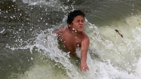 A boy plays in the ocean at Coney Island on Saturday.