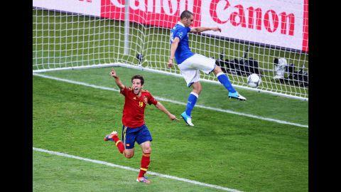 Jordi Alba of Spain celebrates after scoring his team's second goal as Leonardo Bonucci of Italy kicks the ball in frustration.