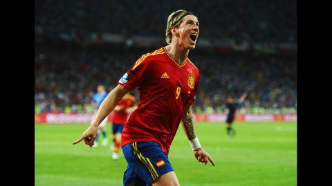 Fernando Torres of Spain celebrates scoring his team's third goal against Italy.