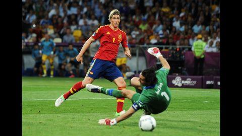 Spain's Fernando Torres nudges the ball toward the goal past Italy's Gianluigi Buffon.
