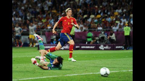 Gianluigi Buffon of Italy looks back at the ball as Spain's Fernando Torres scores.