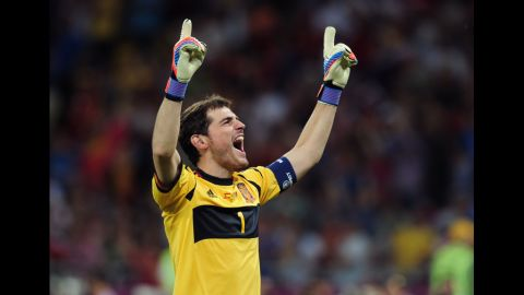 Goalkeeper Iker Casillas of Spain celebrates after his team's third goal against Italy.