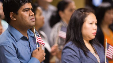 Newly naturalized Americans recite the Pledge of Allegiance at a recent ceremony in Atlanta.