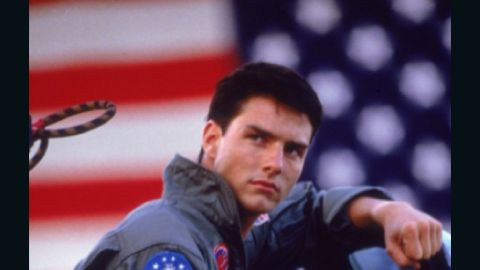 """Cruise's Maverick saved the day and got the girl in 1986's """"Top Gun."""" In real life, the actor married Mimi Rogers in May 1987. They divorced in 1990. Emilio Estevez, Cruise's """"Outsiders"""" co-star, was the best man at their wedding, according to<a href=""""http://www.people.com/people/archive/article/0,,20096360,00.html"""" target=""""_blank"""" target=""""_blank""""> People.</a>"""